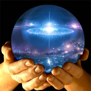 Hands holding the image of the universe in an orb