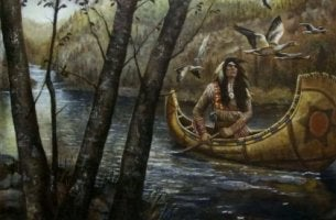 native american rowing in canoe