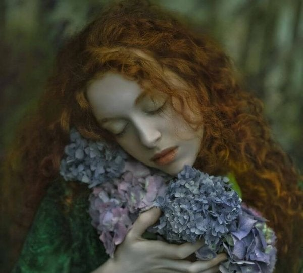 redhead-embracing-gray-flowers