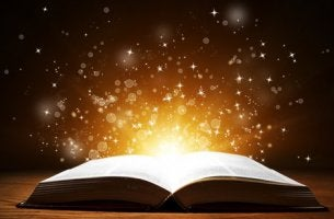 An open book with light coming out of it