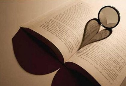 Open book with shadow of a heart