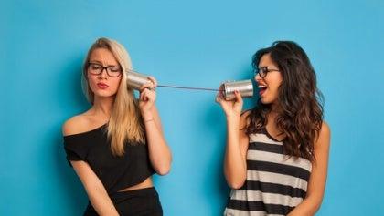 girls-talking-through-can-phone