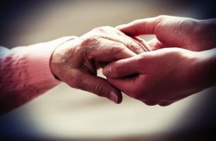 Old hands and your hands holding each other
