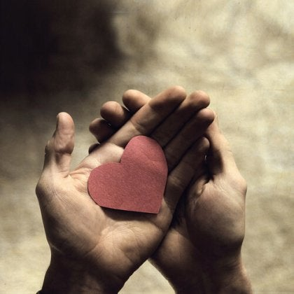 Paper heart in hands