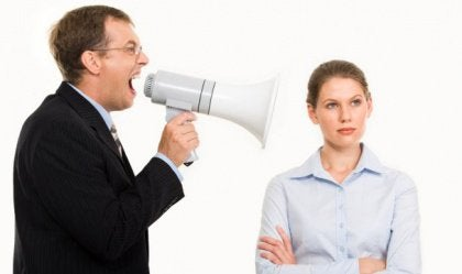 Man yelling at a woman through a megaphone