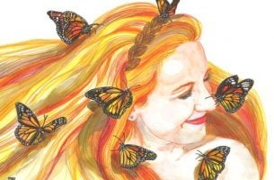 Smiling woman with butterflies