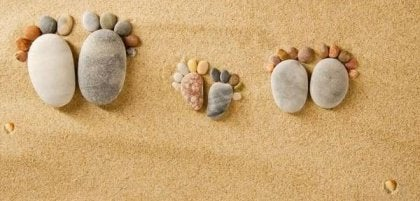 Stones made to look like feet in the sand
