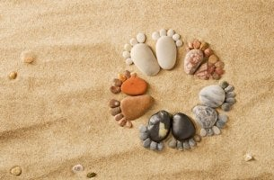 stones arranged like baby feet in a circle