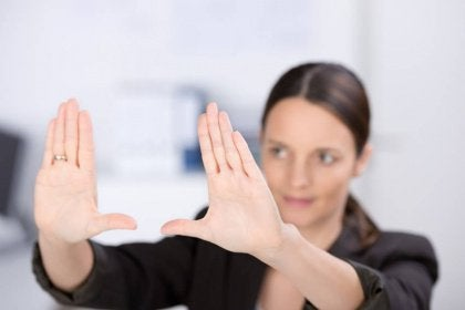 Woman holding up her hands framing something in her imagination