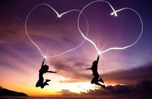 Couple Jumping and Drawing Hearts in the Sky