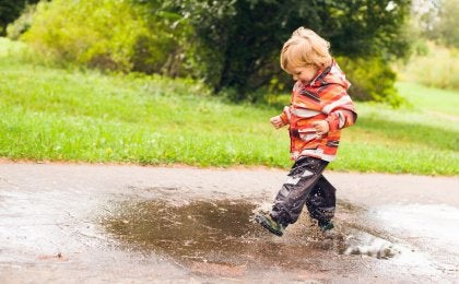 boy jumping puddle