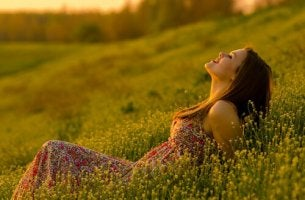 girl smiling lying on grass