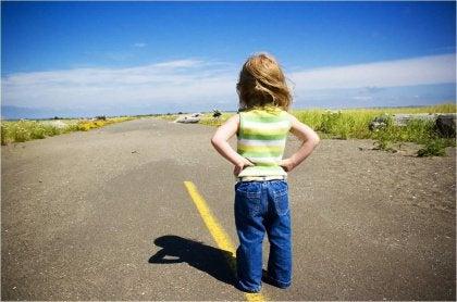 little girl standing on the street