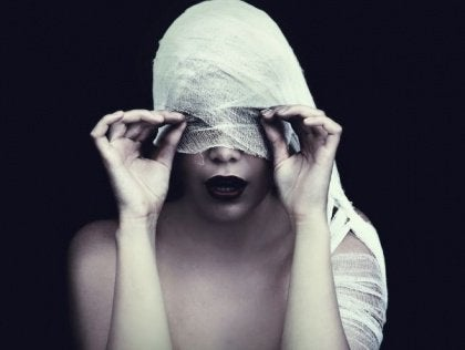 girls eyes covered with fabric