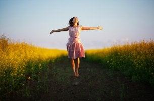 happier woman jumping in a field
