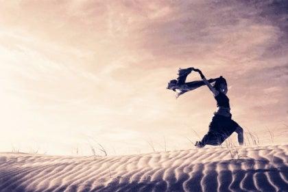 lady running through sand