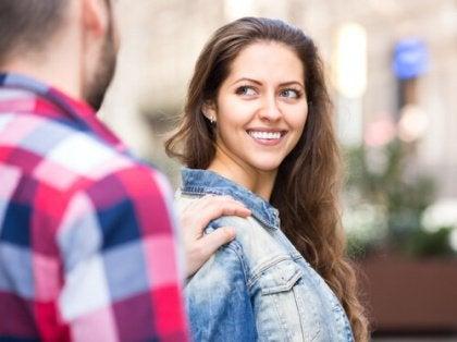 man making woman smile
