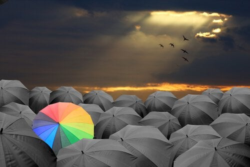 Rainbow Umbrella in a Crowd of Gray