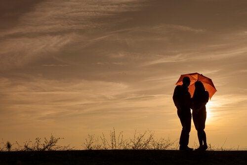 Couple with Umbrella at Sundown