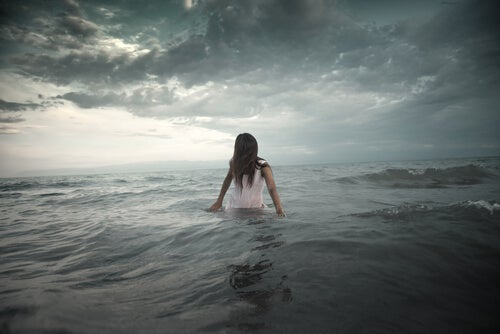 Girl Wading into Waves