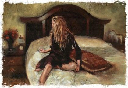 Nainen sängyllä