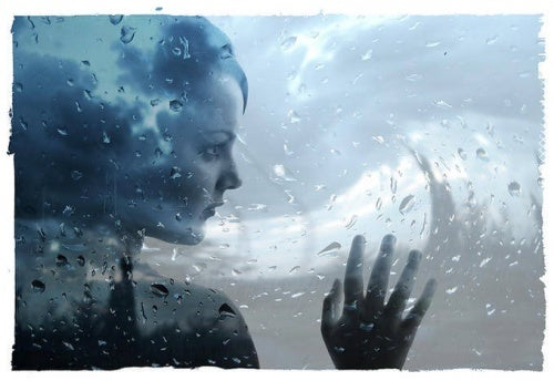 Woman Against Rainy Window