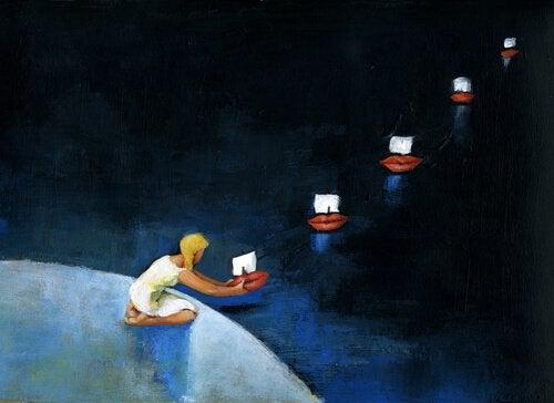 Tyttö laskee veneitä veteen