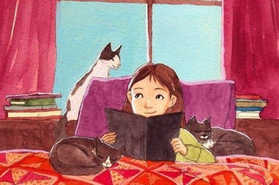 girl reading with cats