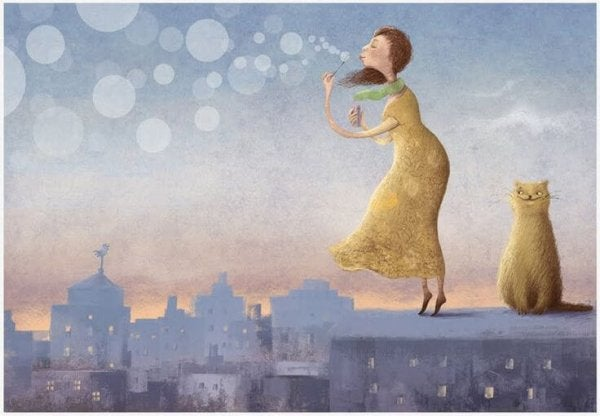 Woman Blowing Bubbles Beside Cat