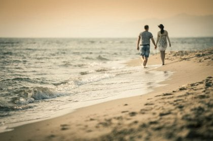 couple walking on the shore