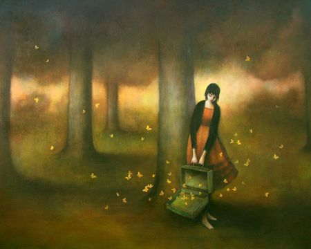 girl with suitcase full of butterflies