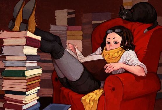 Girl reading with stacks of books