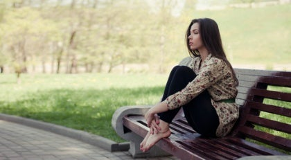 Woman Sitting in Contemplation