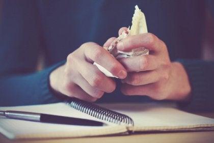 Hands Crumpling Paper