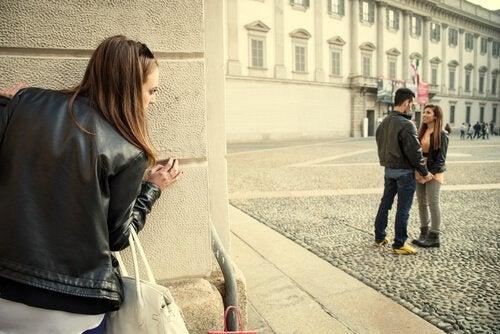 girl spying on couple jealous