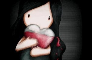 Girl Holding Heart in Arms