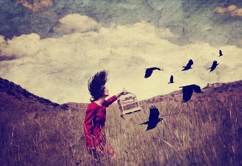 girl with birds in field freedom