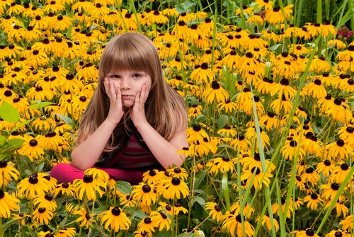 girl sitting in flowers uncomfortable