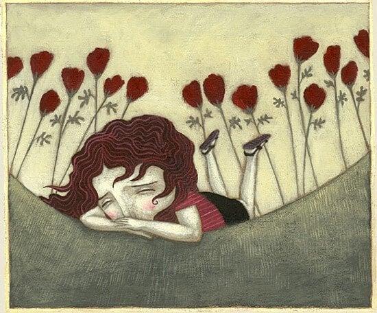 Tyttö itkee maassa