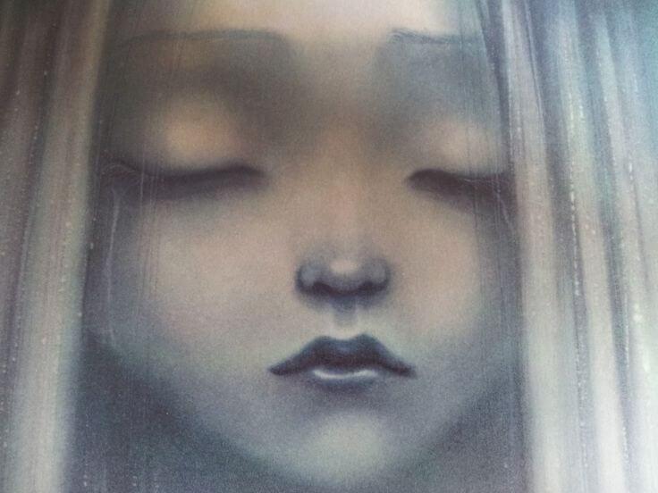 sad girl with eyes closed