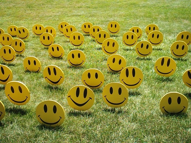 field of smiley faces people