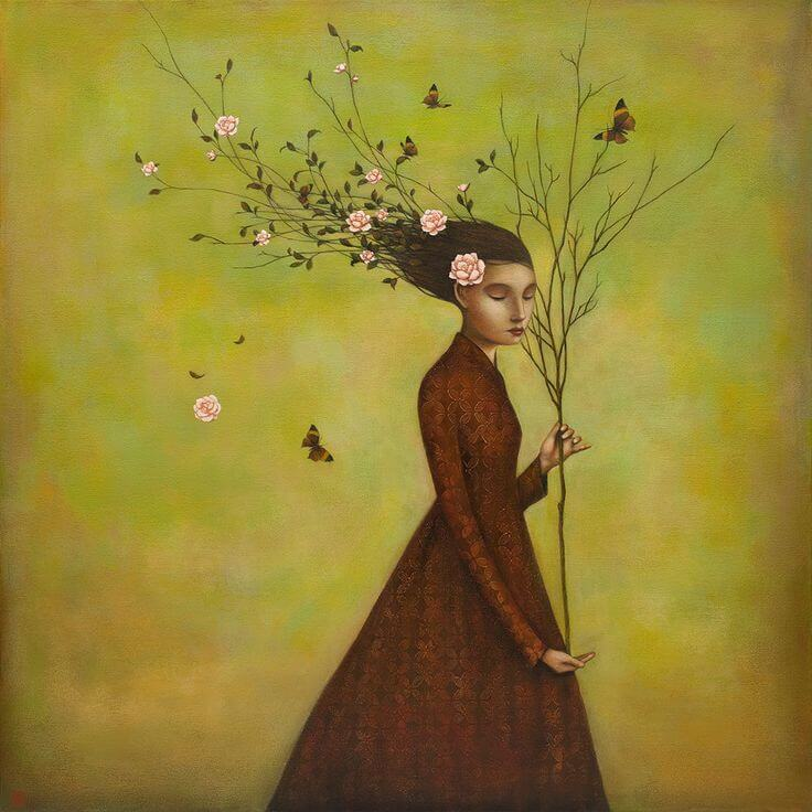 woman holding with a tree without leaves