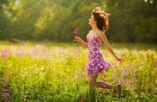 Woman Running Through Field Flower in Hand
