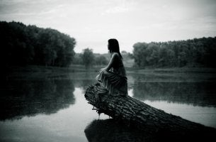 Sad Woman on Log