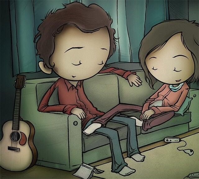Pariskunta nukkuu sohvalla