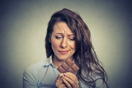 woman with chocolate eat