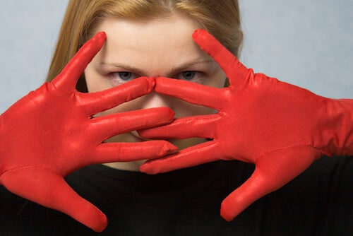 woman wearing red gloves myth