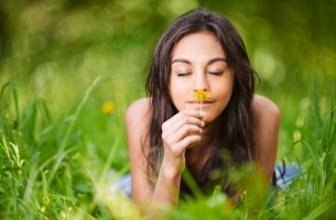 girl smelling flower happiness