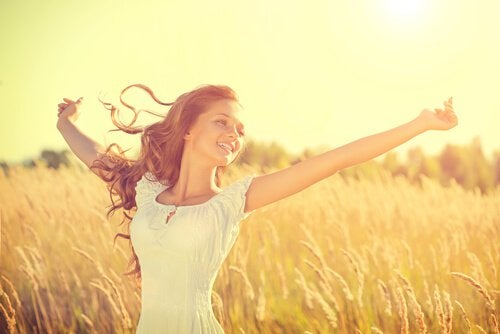 happy free woman in a field