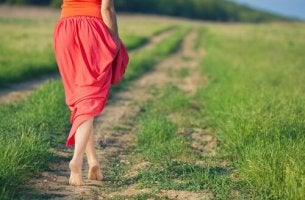 lady in a skirt on a dirt path